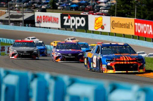 (AP Photo/Julie Jacobson). Chase Elliott (9) leads the pack through the esses during a NASCAR Cup Series auto race, Sunday, Aug. 5, 2018, in Watkins Glen, N.Y.