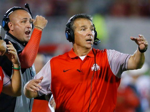 (AP Photo/Sue Ogrocki, File). FILE - In this Sept. 17, 2016, file photo, Ohio State head coach Urban Meyer, right, and then-assistant coach Zach Smith, left, gesture from the sidelines during an NCAA college football game against Oklahoma in Norman, Ok...
