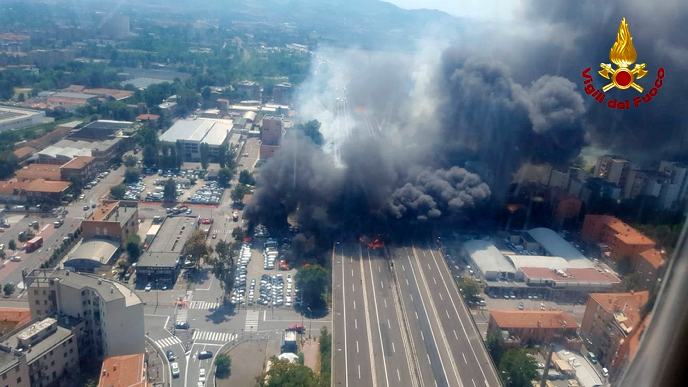 A photo shows a helicopter view of the explosion on a highway in the outskirts of Bologna, Italy, on Monday. The explosion was reportedly caused by an accident involving a truck that was carrying flammable substances. (Vigili Del Fuoco via AP)