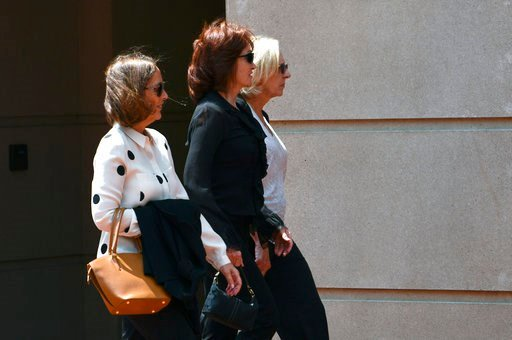 (AP Photo/Susan Walsh). Kathleen Manafort, center, wife of Paul Manafort, walks to the Alexandria Federal Courthouse in Alexandria, Va., Monday, Aug. 6, 2018, for his trial on tax evasion and bank fraud. .