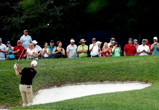 (AP Photo/Jeff Roberson). Jim Furyk hits from a bunker on the fifth hole during a practice round for the PGA Championship golf tournament at Bellerive Country Club, Tuesday, Aug. 7, 2018, in St. Louis.