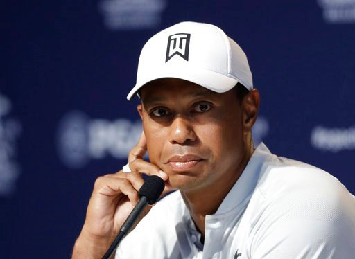 (AP Photo/Darron Cummings). Tiger Woods listens during a news conference at the PGA Championship golf tournament at Bellerive Country Club, Tuesday, Aug. 7, 2018, in St. Louis.
