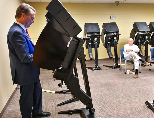 (John Sleezer/The Kansas City Star via AP). Kansas GovernotJeff Colyer advance votes on Tuesday, July 31, 2018. at Hilltop Learning Center in Overland Park, Kansas.