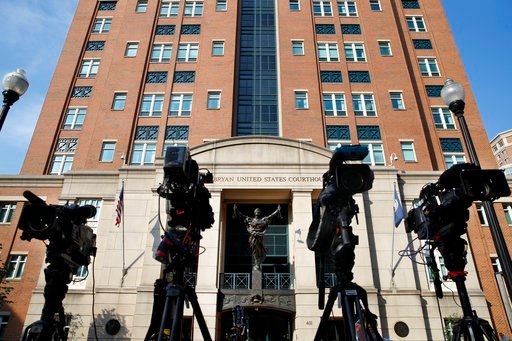 (AP Photo/Jacquelyn Martin). Television cameras stand ready outside the trial of former Trump campaign chairman Paul Manafort at federal court in Alexandria, Va., Tuesday, Aug. 7, 2018.