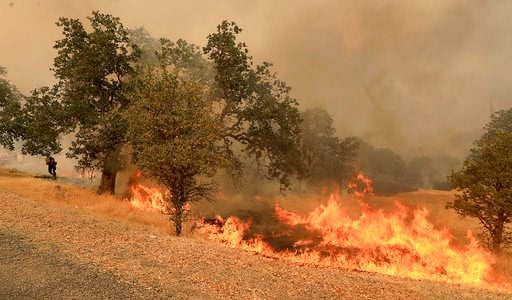 (Kent Porter/The Press Democrat via AP). The Ranch Fire spots out ahead of the main fire in Spring Valley, Calif., Monday, Aug. 6, 2018.