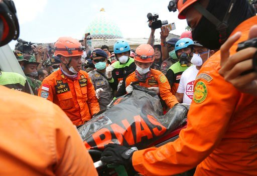 (AP Photo/Tatan Syuflana). Emergency workers recover a body from the Jamiul Jamaah Mosque after it collapsed during an earthquake in Bangsal, North Lombok, Indonesia, Wednesday, Aug. 8, 2018. The north of Lombok was devastated by the powerful quake tha...