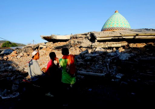 (AP Photo/Tatan Syuflana). Locals view the devastation of a collapsed Jamiul Jamaah Mosque in Bangsal, North Lombok, Indonesia, Wednesday, Aug. 8, 2018. The north of Lombok was devastated by the powerful quake that struck Sunday night, damaging thousan...