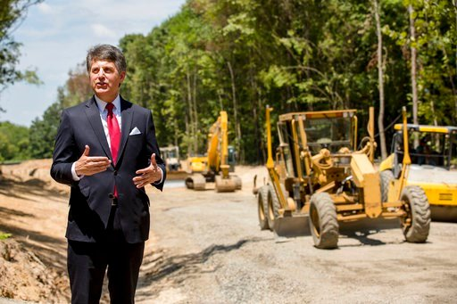 (AP Photo/Karen E. Segrave). In this July 25, 2018, photo, Stephen Bell, president and CEO of the Arkadelphia Area Chamber of Commerce, talks about a new railroad spur that is being built to support the needs of what he hopes will be a new paper mill.