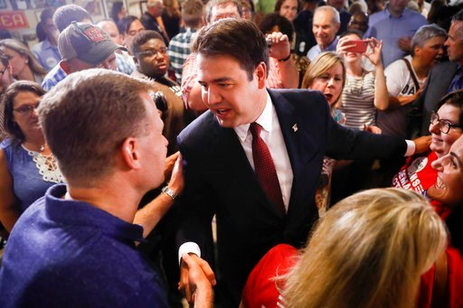 (AP Photo/John Minchillo). Danny O'Connor, the Franklin County recorder, shakes hands with supporters during an election night watch party at the Ohio Civil Service Employees Association, Tuesday, Aug. 7, 2018, in Westerville, Ohio. O'Connor ran agains...