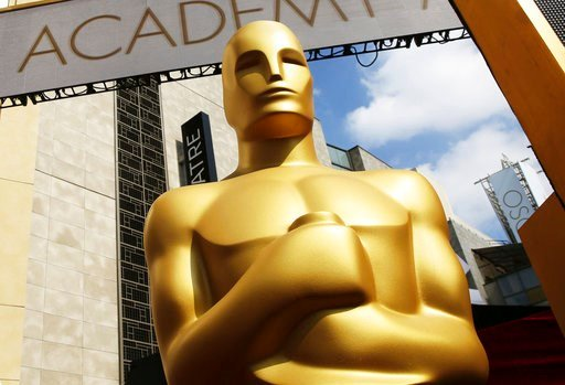 (Photo by Matt Sayles/Invision/AP, File). FILE - In this Feb. 21, 2015 file photo, an Oscar statue appears outside the Dolby Theatre for the 87th Academy Awards in Los Angeles. The Oscars are adding a new category to honor popular films and promising a...