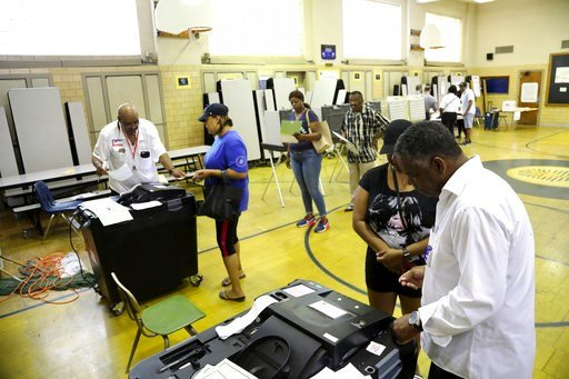 (Kimberly P. Mitchell/Detroit Free Press via AP). Detroit voters cast their vote in the Michigan primaries at Pasteur Elementary in Detroit on Tuesday, Aug. 7, 2018.