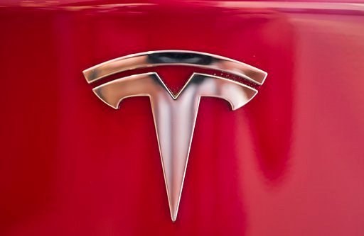 (AP Photo/Richard Vogel). A Tesla emblem is seen on the back end of a Model S in the Tesla showroom in Santa Monica, Calif., on Wednesday, Aug. 8, 2018. Board members at Tesla are evaluating CEO and Chairman Elon Musk's $72 billion proposal to take the...
