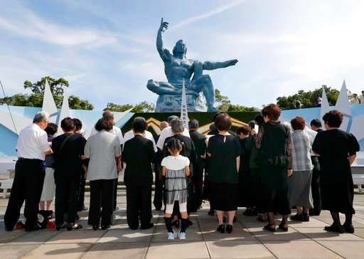 (Takuma Kaneko/Kyodo News via AP). People sing in front of Peace Memorial Statue at Peace Park in Nagasaki, southern Japan, Thursday, Aug. 9, 2018, marking the 73rd anniversary of U.S. bombing on the city.