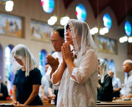 (Takuma Kaneko/Kyodo News via AP). Christians pray for the victims of U.S. atomic bombing during a mass at Urakami Cathedral in Nagasaki, southern Japan, Thursday, Aug. 9, 2018, marking the 73rd anniversary of the bombing on the city.