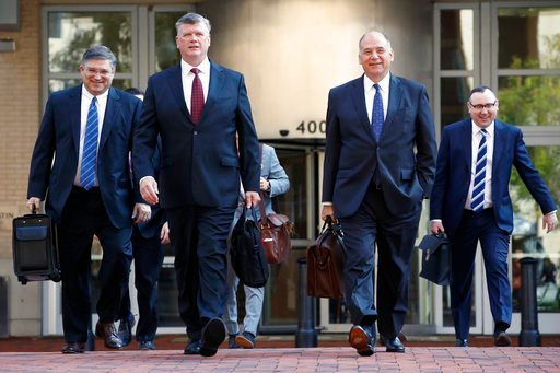 (AP Photo/Jacquelyn Martin). The defense team for Paul Manafort, including Kevin Downing, front left, and Thomas Zehnle, front right, arrive at federal court for the continuation of the trial of the former Trump campaign chairman, in Alexandria, Va.