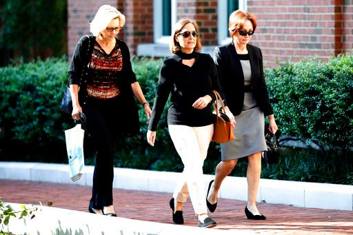 (AP Photo/Jacquelyn Martin). Kathleen Manafort, right, wife of former Trump campaign chairman Paul Manafort, arrives at federal court to attend the trial of her husband in Alexandria, Va., Wednesday, Aug. 8, 2018.