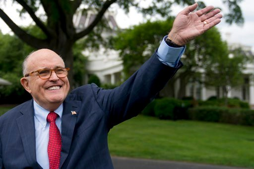(AP Photo/Andrew Harnik, File). In this May 29, 2018, file photo, Rudy Giuliani, an attorney for President Donald Trump, waves to people during White House Sports and Fitness Day on the South Lawn of the White House in Washington.