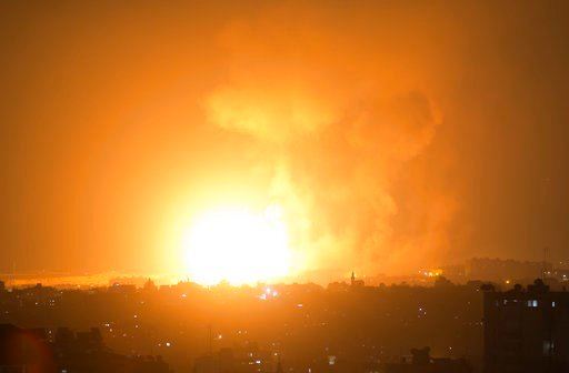 (AP Photo/Khalil Hamra). An explosion caused by Israeli airstrikes on Gaza City, early Thursday, Aug. 9, 2018. Israel struck targets in the Gaza Strip after dozens of rockets were launched Wednesday from the coastal territory ruled by the Islamic milit...