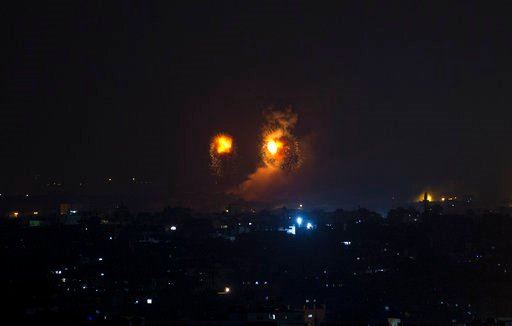 (AP Photo/Khalil Hamra). Fire balls caused by Israeli airstrikes on Gaza City, early Thursday, Aug. 9, 2018.  Israel struck targets in the Gaza Strip after dozens of rockets were launched Wednesday from the coastal territory ruled by the Islamic milita...