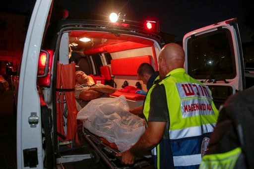(AP photo/Yehuda Peretz). Injured person is taken to ambulance after a missile from Gaza Strip hit in the town of Sderot, Israel, Wednesday, Aug. 7, 2018. Sirens wailed in southern Israel warning of incoming projectiles from Gaza and Israeli media repo...