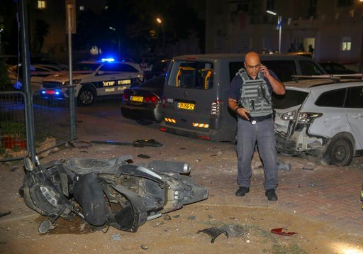 (AP photo/Yehuda Peretz). Israeli security stands at the site where a missile from Gaza Strip hit in the town of Sderot, Wednesday, Aug. 7, 2018. Sirens wailed in southern Israel warning of incoming projectiles from Gaza and Israeli media reported two ...