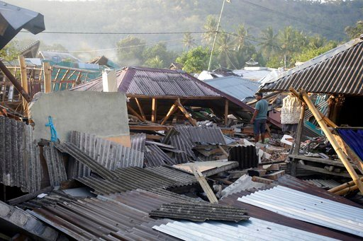 (AP Photo/Firdia Lisnawati). A man inspects the damage of his house destroyed by an earthquake in North Lombok, Indonesia, Thursday, Aug. 9, 2018. The north of Lombok was devastated by the powerful quake that struck Sunday night, damaging thousands of ...