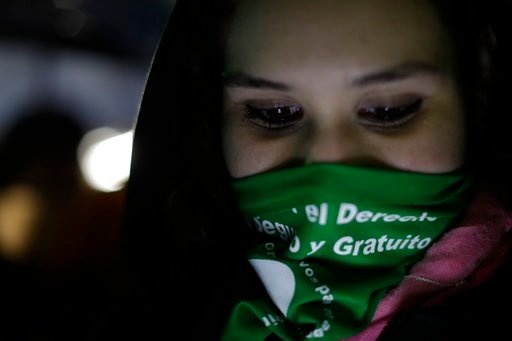 (AP Photo/Natacha Pisarenko). A woman in support of decriminalizing abortion gathers with others outside Congress where lawmakers are debating the issue in Buenos Aires, Argentina, early Thursday, Aug. 9, 2018. The Senate is debating a bill Wednesday t...