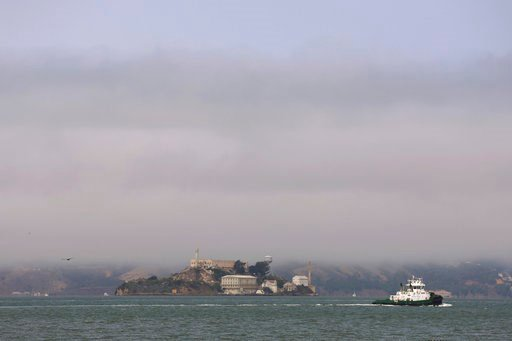 (AP Photo/Lorin Eleni Gill). Hazy air surrounds Alcatraz Island in San Francisco Bay Wednesday, Aug. 8, 2018. The air quality has hit unhealthy levels in cities miles away as California's largest wildfire ever burns to the north.