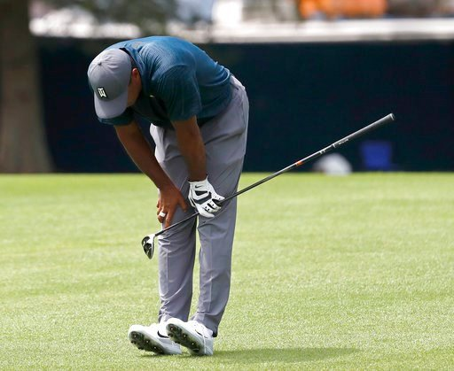 (AP Photo/Jeff Roberson). Tiger Woods reacts to his second shot on the eighth hole during the first round of the PGA Championship golf tournament at Bellerive Country Club, Thursday, Aug. 9, 2018, in St. Louis.