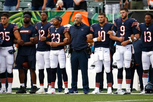(AP Photo/Frank Victores). The Chicago Bears lock arms during the national anthem before the team's NFL preseason football game against the Cincinnati Bengals, Thursday, Aug. 9, 2018, in Cincinnati.