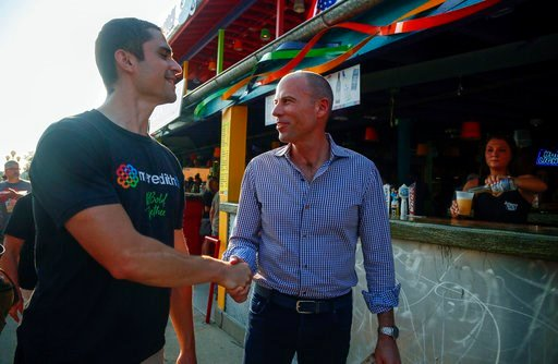 (Zach Boyden-Holme/The Des Moines Register via AP). Michael Avenatti, the lawyer representing adult film actress Stormy Daniels, shakes hands at the Iowa State Fair in Des Moines, Iowa, Thursday, Aug. 9, 2018. Avenatti's crusade for the porn actress ta...
