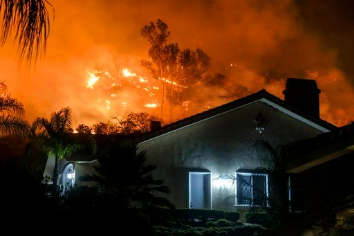 (AP Photo/Ringo H.W. Chiu). The Holy Fire burns in the Cleveland National Forest at a hillside near homes in Lake Elsinore, Calif., Thursday, Aug. 9, 2018.