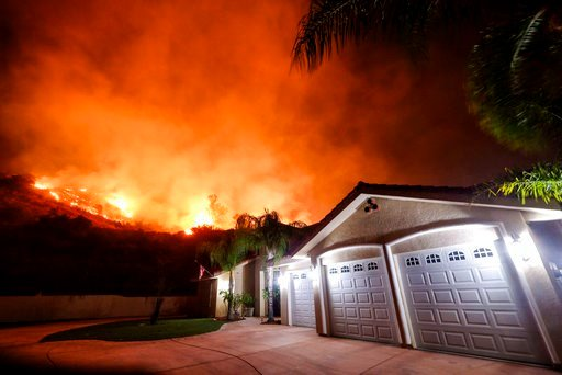 (AP Photo/Ringo H.W. Chiu). The Holy Fire burns near homes in the Cleveland National Forest in Lake Elsinore, Calif., Thursday, Aug. 9, 2018.
