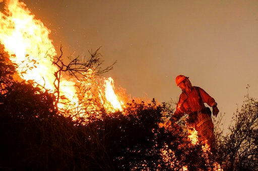 (AP Photo/Ringo H.W. Chiu). A firefighter sets a backburn to fight the Holy Fire as it burns in the Cleveland National Forest along a hillside at Temescal Valley in Corona, Calif., Thursday, Aug. 9, 2018. Firefighters fought a desperate battle to stop ...