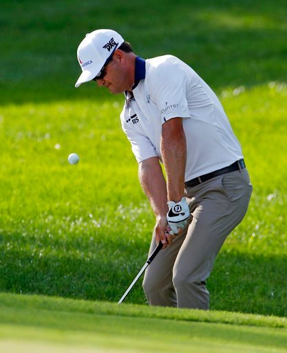 (AP Photo/Charlie Riedel). Zach Johnson chips to the 15th green during the first round of the PGA Championship golf tournament at Bellerive Country Club, Thursday, Aug. 9, 2018, in St. Louis.