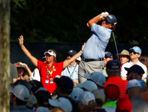 (AP Photo/Jeff Roberson). Phil Mickelson tees off on the 15th hole during the first round of the PGA Championship golf tournament at Bellerive Country Club, Thursday, Aug. 9, 2018, in St. Louis.