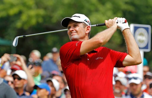 (AP Photo/Charlie Riedel). Justin Rose, of England, watches his tee shot on the sixth hole during the first round of the PGA Championship golf tournament at Bellerive Country Club, Thursday, Aug. 9, 2018, in St. Louis.