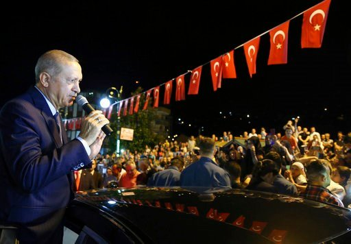"(Presidential Press Service via AP, Pool). Turkey's President Recep Tayyip Erdogan addresses supporters at his Black Sea hometown, Guneysu, Turkey, early Friday, Aug. 10, 2018. Turkey's Finance and Treasury Minister Berat Albayrak will reveal a "" new e..."