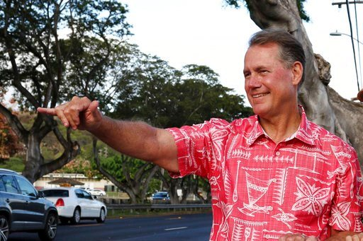 (AP Photo/Audrey McAvoy, File). FILE - In this July 24, 2018, file photo, former U.S. Rep. Ed Case greets evening commuters while campaigning for the U.S. congressional seat representing urban Honolulu, in Honolulu. Hawaii voters head to the polls this...