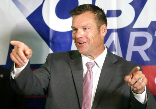 (Thad Allton /The Topeka Capital-Journal via AP). Secretary of State Kris Kobach spoke to the media during a news conference at the Topeka Capitol Plaza hotel in Topeka, Kan., Wednesday, Aug. 8, 2018.