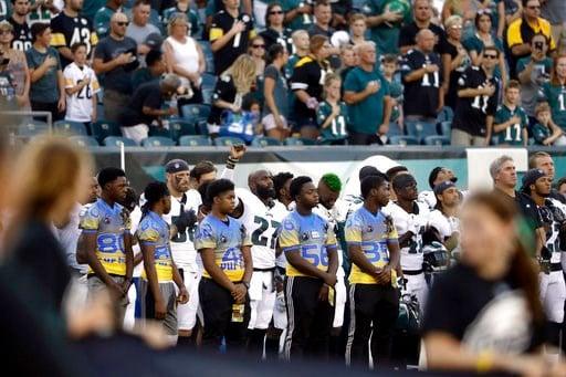 (AP Photo/Matt Rourke). Philadelphia Eagles' Malcolm Jenkins, center left, raises his fist during the national anthem before the team's preseason NFL football game against the Pittsburgh Steelers, Thursday, Aug. 9, 2018, in Philadelphia.
