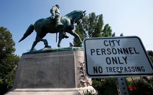 (AP Photo/Steve Helber). In this Monday, Aug. 6, 2018 photo, a No Trespassing sign is displayed in front of a statue of Robert E. Lee in Charlottesville, Va., at the park that was the focus of the Unite the Right rally. Pressure to take down America's ...