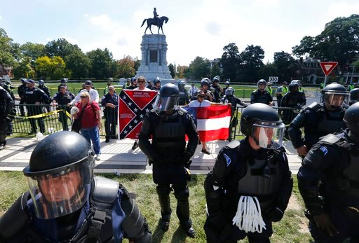 (AP Photo/Steve Helber, File). FILE - In this Sept. 16, 2017, file photo, State Police keep a handful of Confederate protesters separated from counter demonstrators in front of the statue of Confederate General Robert E. Lee on Monument Avenue in Richm...