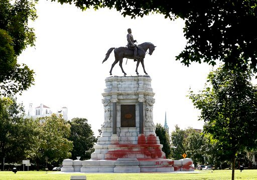 (Mark Gormus/Richmond Times-Dispatch via AP, File). FILE - In this Aug. 4, 2018, file photo, paint covers the base of the Robert E. Lee memorial on Richmond's Monument Avenue in Richmond, Va. Pressure to take down America's monuments honoring slain Con...