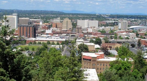 (AP Photo/Nicholas K. Geranios). In this photo taken June 4, 2018, the downtown skyline is shown from the South Hill in Spokane, Wash. . The state's second-largest city is booming these days thanks to a good economy and influx of new residents.