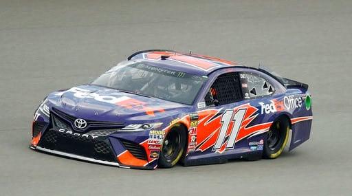 (AP Photo/Paul Sancya). Denny Hamlin qualifies for a NASCAR Cup Series auto race at Michigan International Speedway in Brooklyn, Mich., Friday, Aug. 10, 2018. Hamlin won the pole position.