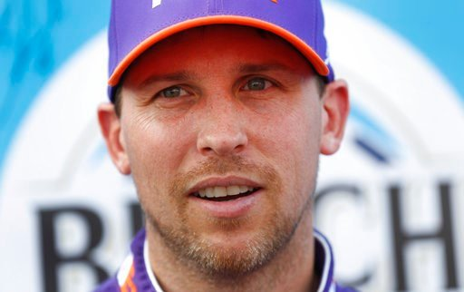 (AP Photo/Paul Sancya). Denny Hamlin talks after winning the pole during qualifications for a NASCAR Cup Series auto race at Michigan International Speedway in Brooklyn, Mich., Friday, Aug. 10, 2018.