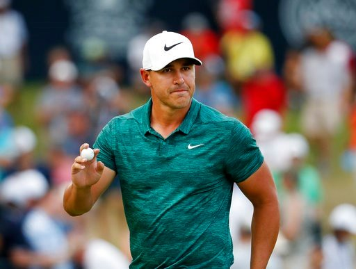 (AP Photo/Jeff Roberson). Brooks Koepka waves to the crowd after making his birdie putt on the 15th green during the final round of the PGA Championship golf tournament at Bellerive Country Club, Sunday, Aug. 12, 2018, in St. Louis.