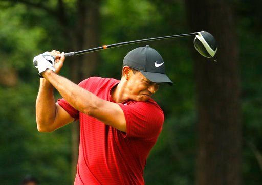 (AP Photo/Charlie Riedel). Tiger Woods reacts to his drive on the 17th hole during the final round of the PGA Championship golf tournament at Bellerive Country Club, Sunday, Aug. 12, 2018, in St. Louis.