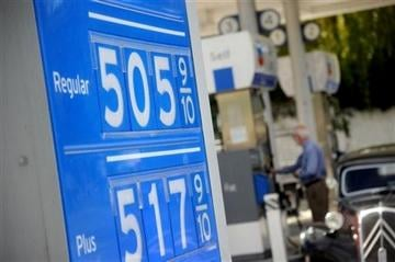 (AP Photo/Noah Berger). Gasoline prices higher than $5 per gallon are posted at a Menlo Park, Calif., Chevron station  on Friday, Oct. 5, 2012.